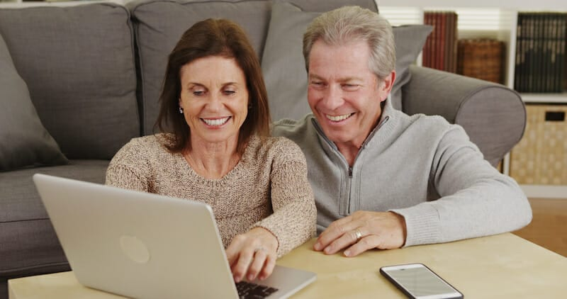 older couple using laptop